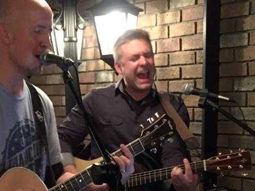 Mike Bitton playing guitar with Jim McCutcheon of Jim'n'Tonic